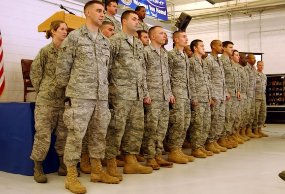 "ANDREWS AIR FORCE BASE, Md. -- Members of the 459th Security Forces Squadron listen to kudos on stage during ""Tribute to Troops,"" an event hosted by the 459th Mission Support Flight to thank returning troops for their various deployments during the last year. The event was emceed by Senior Airman Patrick Stout of the 69th Aerial Port Squadron. (U.S. Air Force photo/Senior Airman Ashley Crawford)"