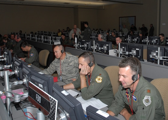 Maj. Rob Alford (right), Maj. Paul Rockway (middle), and Capt. Joe Ingram (left), students at the 505th Training Squadron, manage and monitor fighter aircraft during an end of course exercise March 19 at Hurlburt Field. The exercise tests operational level command and control in an air operations center. (U.S. Air Force photo/Airman 1st Class Jason Epley)