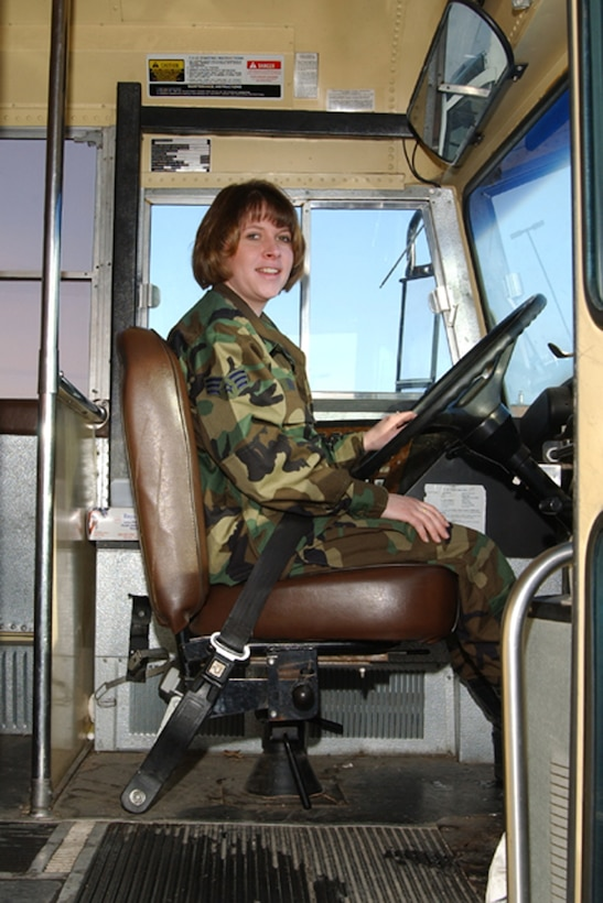 119th Wing member of the transportation and vehicle maintenance squadron drives a bus on base.