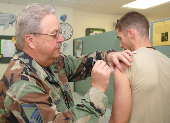 PATRICK AIR FORCE BASE, Fla. - Air Force Reservist Senior Master Sgt. Thomas Mendenhall, 920th Aeromedical Staging Squadron, administers a vaccination to Army Capt. Scott Newman in the immunization clinic. Air Force Reserve medical staff keep Servicemembers ready for deployments by maintaining immunization currency for more than 1,200 rescue wing Airmen as well as other military services' warriors who drill at Patrick AFB.  Leading from the front, Air Force reservists undergo the same training as Regular Component Airmen and meet or exceed the same high standards. (U.S. Air Force Photo/Staff Sgt. Heather L. Kelly)