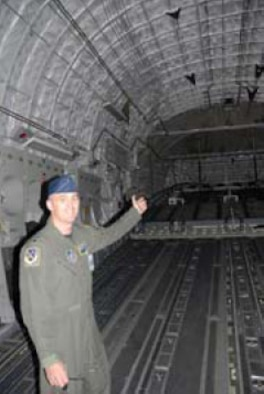 Lt. Col. Carl Lincoln shows off the Globemaster's roomy cargo area, one of many military-specific design features.