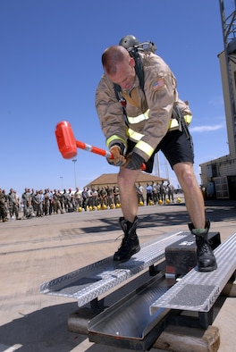 Marine Staff Sgt. Charles Ammon, SAM Squad Firefighter Combat Challenge team member makes the obstacle course look easy, as he is ranked 6th in the World. (U.S. Air Force photo by Senior Airman Kamaile Chan)