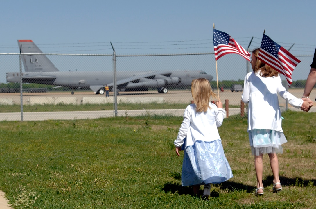 Two young girls wait for the 307th RED HORSE Squadron to return from their six month deployment to Iraq, Sunday April 13th. (U.S. Air Force photo by TSgt Laura K. Smith)(Released)