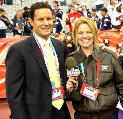 FOX News personality Brian Kilmeade stops to take a photo with fellow Super Bowl Correspondent Tech. Sgt. Angela Walz, 162nd Fighter Wing public affairs. (Air National Gaurd photo by Senior Airman Sarah Flint)
