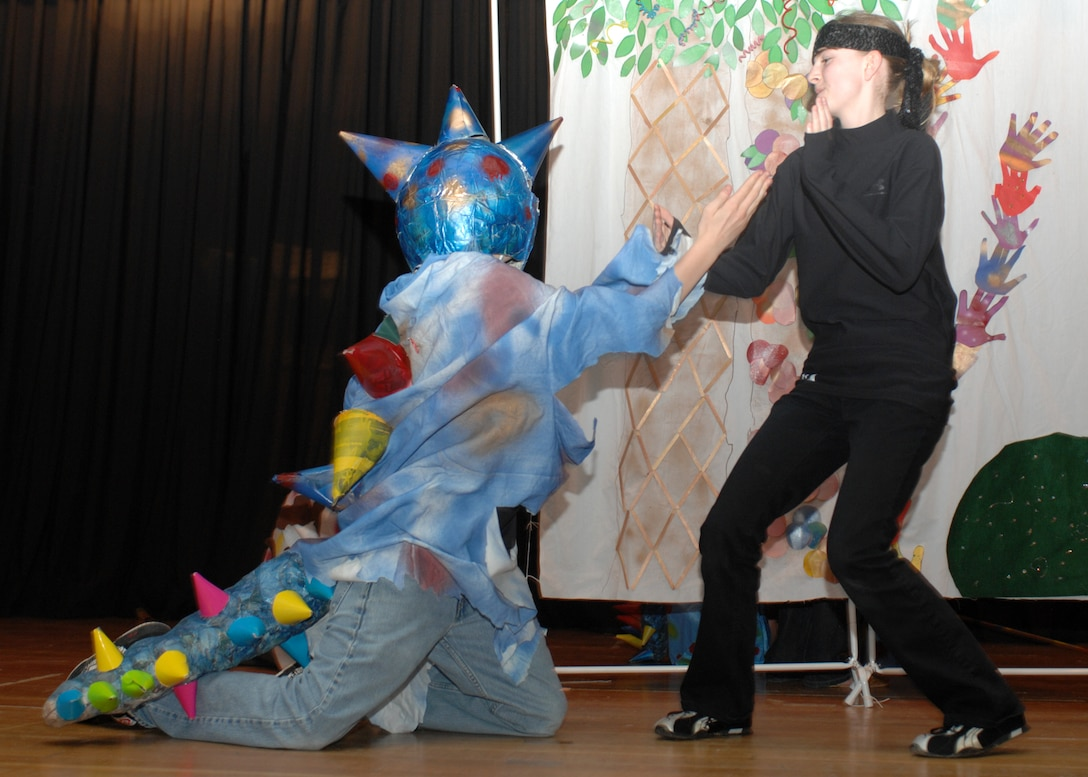 SPANGDAHLEM AIR BASE, Germany -- Ninja, Elizabeth Buchholz, shows exactly how the dinosaurs became extinct against dinosaur, Paul Naisbitt, during their performance at the Spangdahlem Middle School's Odyssey of the Mind dinner theater and chili cook-off fundraiser April 15, 2008. Elizabeth and Paul are members of one of the four teams from Spangdahlem going to the world competition to be held in Maryland later in May. (Air Force photo/Airman 1st Class Jenifer Calhoun)