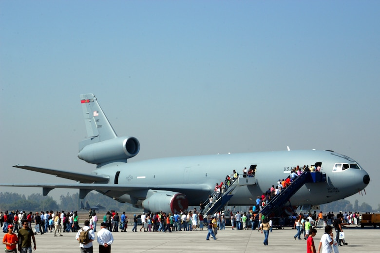 SANTIAGO, Chile -- Patrons of FIDAE 2008 wait in line to board a KC-10 Extender at FIDAE 2008 April 5.  The aircraft is from the 349th Air Mobility Wing, Travis AFB, Calif.  The KC-10 as well as a host of other Airmen and aircraft were part of the South American air show and Exercise Newen 2008.  The exercise emphasizes cooperation and partnerships between the U.S. and Chilean militaries. (U.S. Air Force photo/Master Sgt. Jason Tudor)