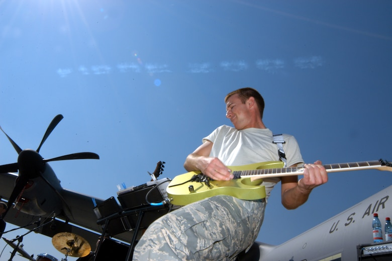 SANTIAGO, Chile -- Airman 1st Class Aaron Kusterer rips a guitar solo during a performance at FIDAE 2008 April 5.  Airman Kusterer is a member of the Air National Guard Band of the Central States.  The band as well as a host of other Airmen and aircraft were part of the South American air show and Exercise Newen 2008.  The exercise emphasizes cooperation and partnerships between the U.S. and Chilean militaries. (U.S. Air Force photo/Master Sgt. Jason Tudor)