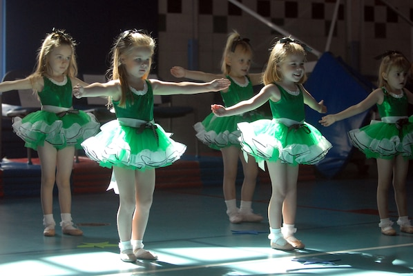 Dancers from the 3-and 4-year-old class in the Randolph Youth Center dance program perform the Five Positions ballet during the recital presented at Randolph?s Fam-a-Ganza celebration Saturday. The event attracted a large crowd from the base community. (U.S. Air Force photo by Steve White)