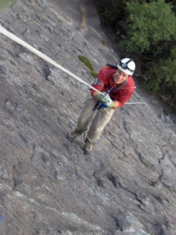 The 35-year-old engineer ascends the rope up a 700-foot rock face in Whiteside, N.C. with friend and coworker, Alan Hale (not pictured), who was teaching Watts some new skills in September 2005. (Photo provided)