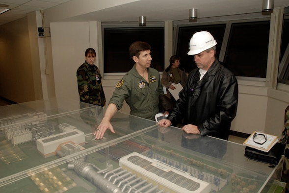 General Lanni asks questions about the Aeropropulsion Systems Test Facility (ASTF) to Mark Grantham. (Photo by Rick Goodfriend)