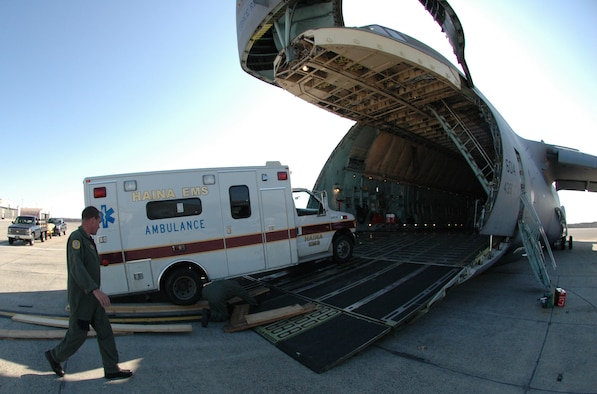 Airmen at Westover Air Reserve Base, Mass., load an ambulance bound for the Dominican Republic April 16.