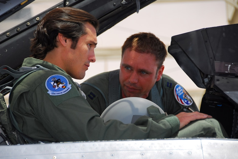 F-16 pilot, Capt. Jason Lewis (right) checks on Joe Nichols before his orientation flight with the 162nd Fighter Wing.