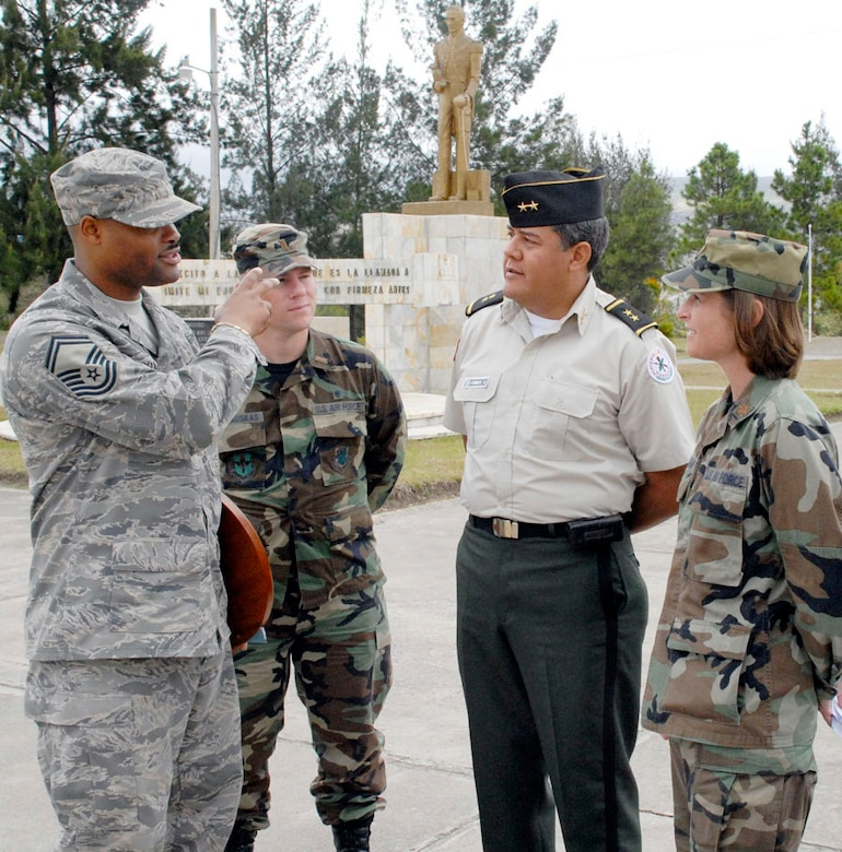 SOTO CANO AIR BASE, Honduras--Air Force Senior Master Sgt. Les Bramlett, 2nd Lt. Zack Kalinauskis and Maj. Tiffany Morgan visit with Lt. Col. Raynel Funes, Honduran Military Training Academy deputy director, during an information exchange and tour of the Honduran Military Training Academy in Tegucigalpa, Honduras April 16.  (U.S. Air Force photo by Tech. Sgt. William Farrow)