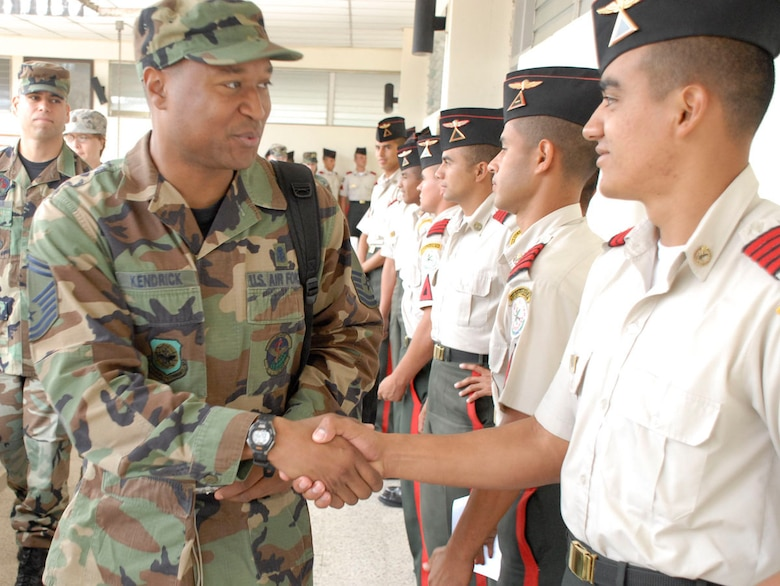 SOTO CANO AIR BASE, Honduras--Air Force Senior Master Sgt. Anthony Kendrick is greeted by a cadet at the Honduran Military Training Academy in Tegucigalpa, Honduras April 16. Sergeant Kendrick briefed senior cadets on the importance continuous enlisted professional military education plays in the career of U.S. military?s enlisted corps. (U.S. Air Force photo by Tech. Sgt. William Farrow)