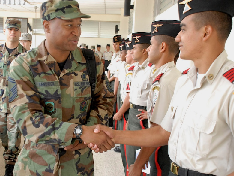 Senior Master Sgt. Anthony Kendrick is greeted by a cadet April 16 at the Honduran military training academy in Tegucigalpa, Honduras. Sergeant Kendrick, a member of Joint Task Force-Bravo from Soto Cano Air Base, Honduras, briefed senior cadets on the importance continuous enlisted professional military education plays in the career of U.S. military's enlisted corps. (U.S. Air Force photo/Tech. Sgt. William Farrow)