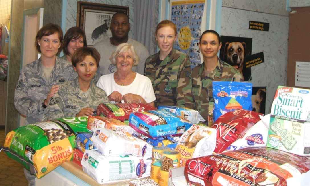 Members of the Air Force Personnel Center Junior Enlisted Council show off some of the donations raised recently to support the Universal City Animal Shelter. The council raised 756 pounds of food, 224 pounds of cat litter, 16 pounds of treats and $155. From left, front row, are Tech. Sgt. Sara Montes and Aina Blake; back row, Tech. Sgt. Sandra Deason, Staff Sgt. Tonya Posey, Sharod White, Staff Sgt. Simona Patrick and Senior Airman Janina-Eva White. (U.S. Air Force photo/File)