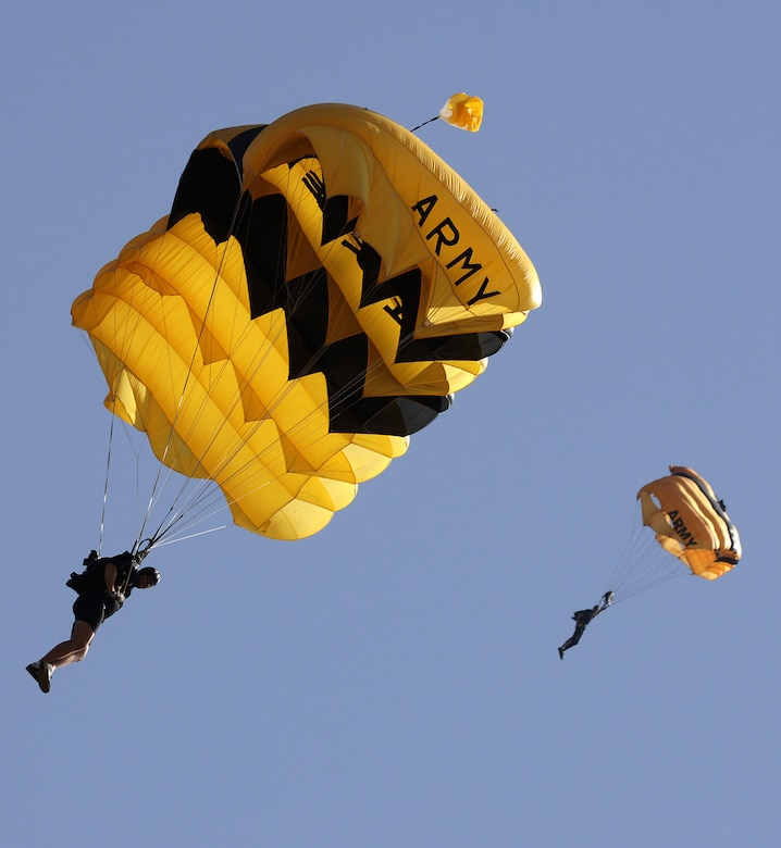 Two Army Soldiers from the Golden Knights Parachute Team come down underneath their parachute canopy at the Military World Games in Hyderabad, India, Oct. 14, 2007. The Golden Knights will perform at the 2008 ?Wings Over Charleston? Air Expo. (U. S. Air Force photo/Master Sgt. Glenda Lynchard