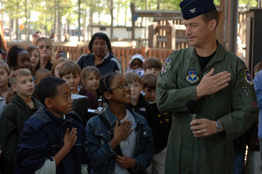 Col. Dave Gerber, 14th Flying Training Wing Commander, demonstrates the proper placement of the hand to students before the pledge of allegiance to kick off the Annual Earth Day event.  (U.S. Air Force photo by Airman Josh Harbin)