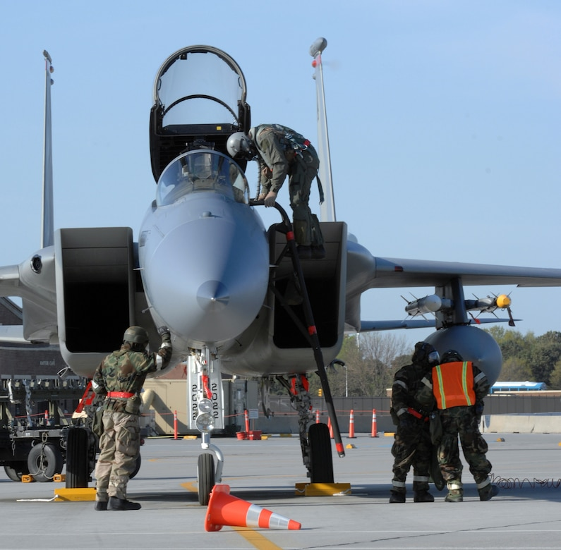 Airmen from the 71st Fighter Squadron perform maintenance during an Operational Readiness Inspection April 15 while wearing chemical protective gear.  The ORI tested Airmen's ability to survive and operate in a deployed environment.  (U.S. Air Force photo/Senior Airman Vernon Young)