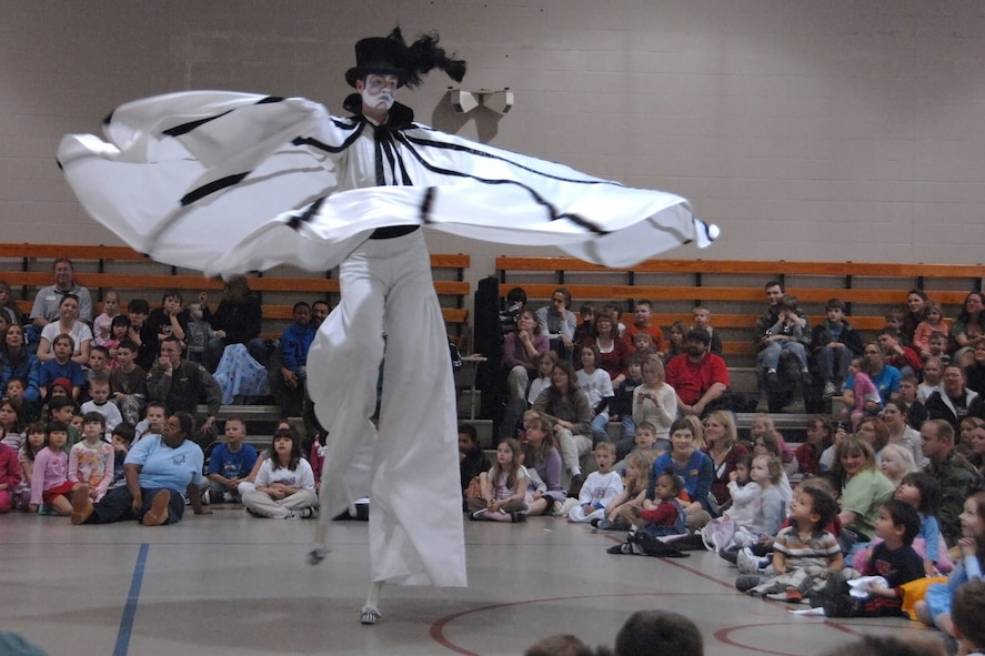 Cirque du Soleil performer 'Creator' wows Offuttchildren with his stilt-walking twirling skills. The Cirque de Soleil's Saltimbanco touring troupe came to Offutt as part of a special 'Month of the Military Child' event during their regular promotional stops for their show in Omaha. (U.S. Air Force Photo/Josh Plueger)