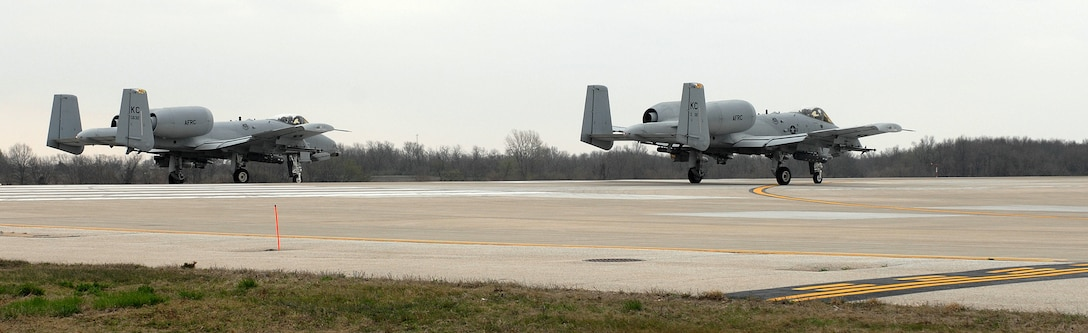 Two A-10 Thunderbolt IIs stand by on the runway awaiting clearance from the air traffic control tower for take-off from Whiteman Air Force Base, Mo., April 17. The A-10s are piloted by members of the 303rd Fighter Squadron, part of the 442nd Fighter Wing, an Air Force Reserve Command unit at Whiteman. (U.S. Air Force photo/Tech. Sgt. Samuel A. Park)