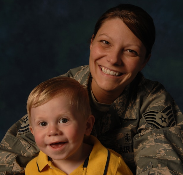 WHITEMAN AIR FORCE BASE, Mo.--Tech. Sgt. Kristy Earls, an Airman Leadership School instructor, poses with her son, Jackson, April 23. Sergeant Earls was recently recognized for saving the life of a young boy by performing the Heimlich maneuver. She states that as a mother she tries to always be prepared for certain situations. (U.S. Air Force photo/Senior Airman Stephanie Clark)