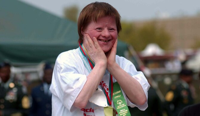 Marlene Belitz, from Tagesförderstätte Logo in Pirmasens, reacts to the crowd's applause after receiving a gold medal at the 2006 U.S. Army Garrison Kaiserslautern Special Olympics Spring Games at the Police Academy in Enkenbach-Alsenborn. This year's games will be held May 6 at the academy. Photo by Christine June