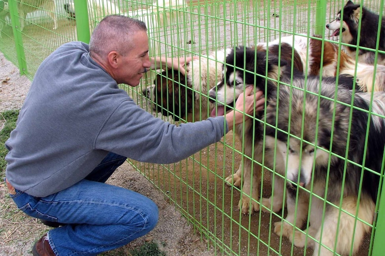 Master Sgt. Henry Cummings, 51st Maintenance Operations Squadron gives residents of the Korean Animal Protection Society's Boeum Shelter some tender-loving care during a visit to the facility April 13. (U.S. Army photo/Stacy A. Ouellette)
