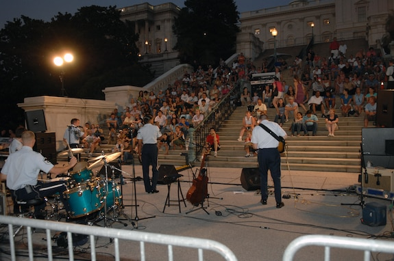 The United States Air Force Band's Silver Wings performs on the steps of the U.S. Capitol in August 2007. During the summer months, different components of the USAF Band provide free public concerts at various outdoor venues around Washington, D.C., including the steps of the U.S. Capitol, the base of the Washington Monument, and the Air Force Memorial in Arlington, Va. (Official Air Force photo by Airman 1st Class Rusti Caraker)