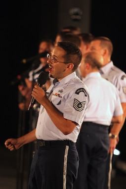 Tenor vocalist Technical Sgt. Joseph Haughton performs with the Men's Chorus of the Singing Sergeants and the USAF Concert Band at the Air Force Memorial in August 2007. During the summer months, different components of the USAF Band provide free public concerts at the base of the Air Force Memorial in Arlington, Va. (Official Air Force photo by Senior Master Sgt. Robert Mesite)