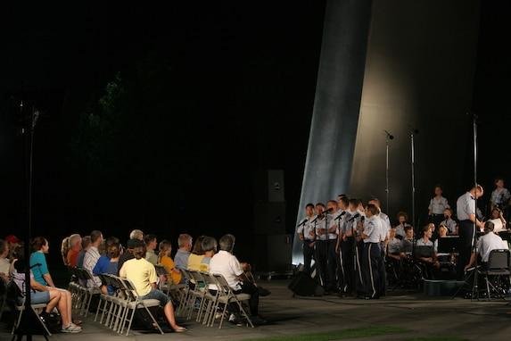 The Men's Chorus of the Singing Sergeants perform with the USAF Concert Band at the Air Force Memorial in August 2007. During the summer months, different components of the USAF Band provide free public concerts at the base of the Air Force Memorial in Arlington, Va. (Official Air Force photo by Senior Master Sgt. Robert Mesite)