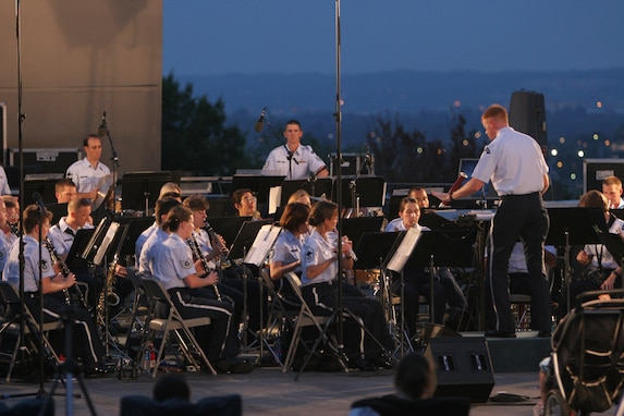 Captain Michael Murray conducts the USAF Concert Band at the Air Force Memorial in August 2007. During the summer months, different components of the USAF Band provide free public concerts at the base of the Air Force Memorial in Arlington, Va. (Official Air Force photo by Senior Master Sgt. Robert Mesite)