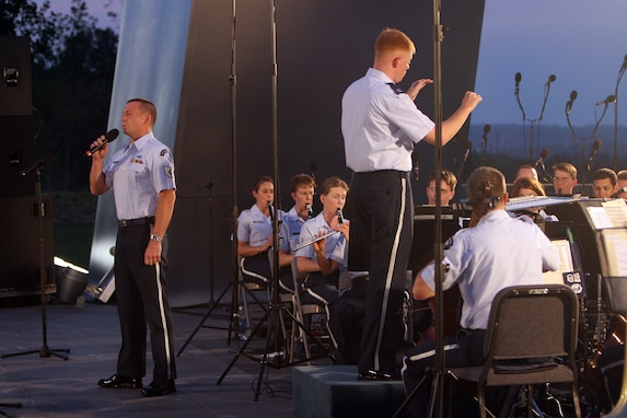 Tenor vocalist Technical Sgt. Taylor Armstrong performs in August 2007 at a summer concert with the USAF Concert Band at the Air Force Memorial. During the summer months, different components of the USAF Band provide free public concerts at the base of the Air Force Memorial in Arlington, Va. (Official Air Force photo by Senior Master Sgt. Robert Mesite)