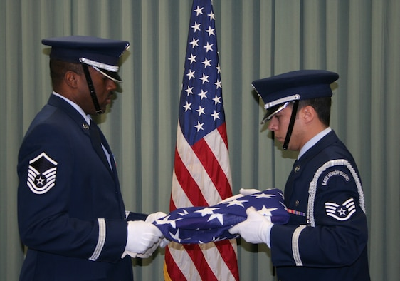 WRIGHT-PATTERSON AFB, Ohio - Master Sgt. Mark Lyle and Staff Sgt. Jimmy Montalvo, Jr. of the 445th Airlift Wing Honor Guard fold a flag during a recent retirement ceremony.  (U.S. Air Force photo/Senior Airman Ken LaRock)