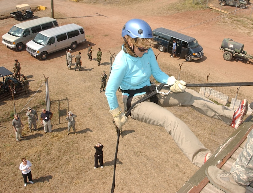 Lucia Dougherty, a Joint Civilian Orientation Conference participant, rappels off the tower at Soto Cano Air Base, Honduras. JCOC visited Soto Cano Air Base Apr. 24 as part of a tour of locations throughout the U.S. Southern Command area of responsibility. (Photo by Martin Chahin)