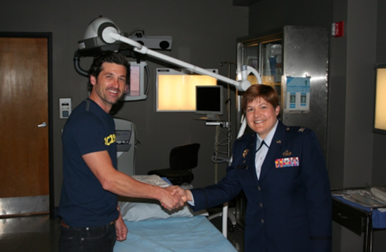 61st Mission Support Group Commander Col. Nannette Benitez coins actor Patrick Dempsey on the set of Grey's Anatomy, April 17.