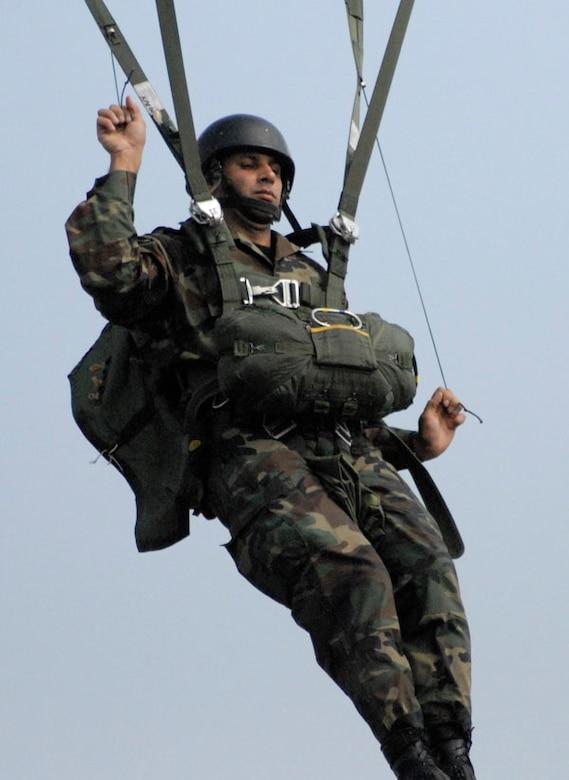 SOTO CANO AIR BASE, Honduras-A paratrooper falls toward the Tamara Drop Zone near Tegucigalpa, Honduras, April 23 during Iguana Voladora 2008, a combined airborne operation in which jumpers represented 17 American countries.