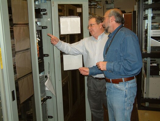 James Johnson and Michael Poli, U.S. Air Forces in Europe CSS Quality Assurance evaluators, conduct a contract surveillance at the Spangdahlem Technical Control Facility. The evaluators assess the contractor's performance on the Northern Communications contract through scheduled and unscheduled surveillances at multiple sites throughout Europe.