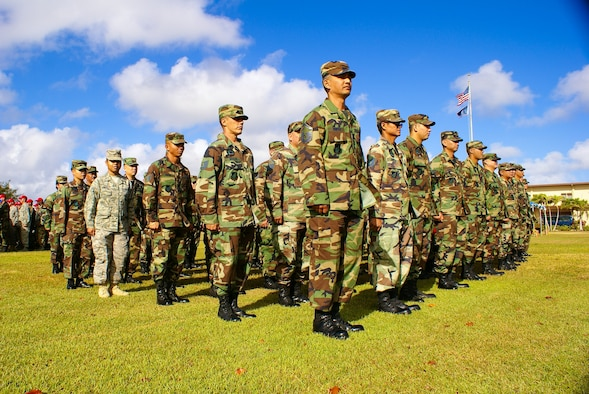 Members of the Guam Air National Guard's 254th Civil Engineer Squadron stand by with excitement during a Flagging Ceremony at Andersen Air Force Base as they convert to the 254th REDHORSE Squadron April 4. They will be an ssociate unit with the Air Force's 554th RED HORSE Squadron. (Courtesy Photo)