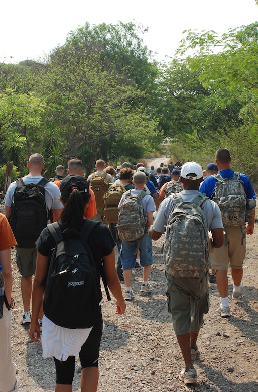 Joint Task Force-Bravo personnel head out to deliver two and one half tons of staple foods to two villages near Humuya, Honduras, April 26. The three-mile hike was part of JTF-Bravo's ongoing chapel hike program. (U.S. Air Force photo by 1st Lt. Erika Yepsen)