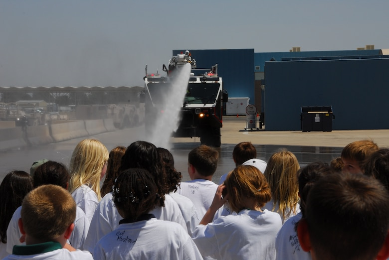 Wright Flight students watch a fire truck demonstration at the 162nd Fighter Wing firehouse. The tour showed local school kids several examples of jobs found in the Air National Guard. (Air National Guard photo by Master Sgt. Dave Neve)
