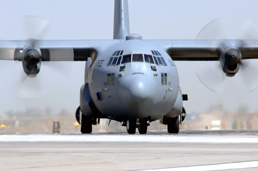 A C-130 Hercules taxis at Balad Air Base, Iraq, after an Operation Iraqi Freedom mission. The C-130 provides intra-theater heavy airlift throughout Southwest Asia.  The C-130 is deployed from the Colorado Air National Guard's 439th Airlift Wing in Colorado Springs. (U.S. Air Force photo/Staff Sgt. Tony R. Tolley)