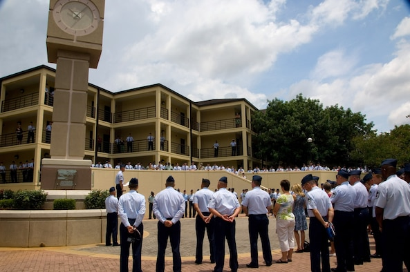 More than 400 enlisted members and guests attend the dedication of the Air Force Senior NCO Academy class 08-Delta's legacy project. The clock tower memorializes the tragic events of Sept. 11, 2001. (Air Force photo by Melanie Rodgers)
