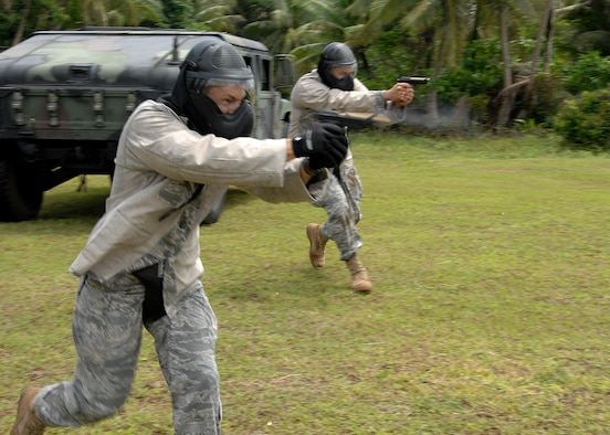 Staff Sgt. Daniel Gonzalez from Kadena Air Base, Japan and Staff Sgt. Robert Bishop from Misawa Air Base, Japan participate in  a live fire scenario during the Commando Warrior Simuntions training exercise July 30 at Andersen Air Force Base, Guam. 