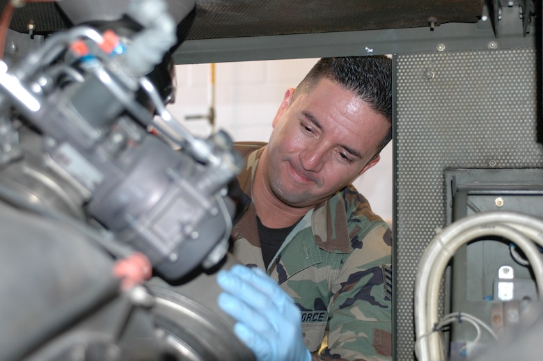 "Staff Sgt. Brian Brewer, power support systems technician, removes the combustion can from the ""Dash 60"" unit to inspect the igniter and atomizer as part of an inspection. Sergeant Brewer has inspected and repaired AGE equipment since he joined the 162nd in 2000. (Air National Guard photo by Staff Sgt. Jordan Jones)"