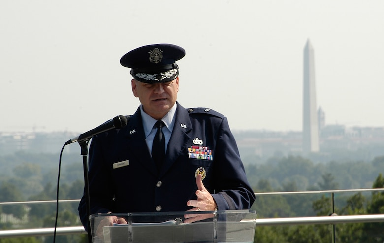 Brigadier General Dana Simmons, Air Force Office of Special Investigations Commander, delivers a speech celebrating 60 years of proud service from the men and women of AFOSI Aug.1 at the Air Force Memorial. Behind him in the distance is the Washington Momument. (U.S. Air Force photo/Tech. Sgt. John Jung)