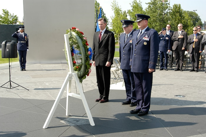 In observance of the 60th Anniversary of the Air Force Office of Special Investigations a wreath is placed at the Air Force Memorial Aug. 1. In a moment of solemn observance are (l to r) Mr. Douglas Thomas, AFOSI Executive Director, Command Chief Master Sgt. Chris Redmond, AFOSI Command Chief and Brig. Gen. Dana Simmons, AFOSI commander. (U.S. Air Force photo/Tech. Sgt. John Jung)