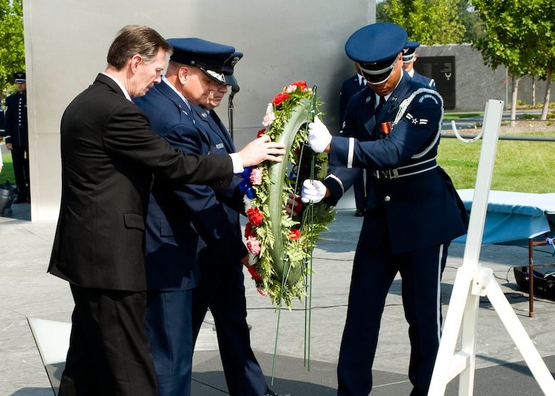 In observance of the 60th Anniversary of the Air Force Office of Special Investigations a wreath is placed at the Air Force Memorial Aug. 1. Positioning the wreath are (l to r) Mr. Douglas Thomas, AFOSI Executive Director, Brig. Gen. Dana Simmons, AFOSI commander, Command Chief Master Sgt. Chris Redmond, AFOSI Command Chief, and an Airman from the Air Force Honor Guard. (U.S. Air Force photo/Mike Hastings)