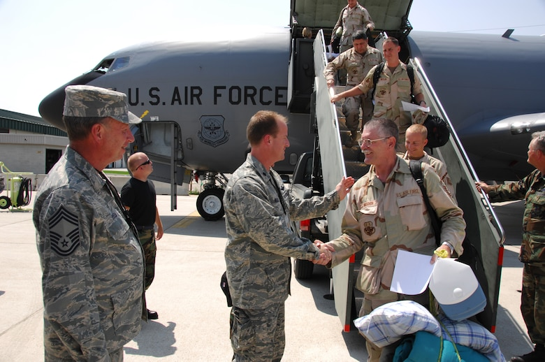 Members of the Utah Air National Guard's 151st Air Refueling Wing disembark from their KC-135R Stratotanker after returing home from a deployment to Manas Air Base, Kyrgyz Republic.   Over 130 members of the 151st deployed to Manas for two months helping to keep the Stratotankers in the air while supporting refueling missions over Afghanistan. (RELEASED) USAF photo by Tech. Sgt Mike Evans