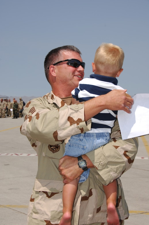 SALT LAKE CITY - Staff Sgt. Gregory Wilson of the Utah Air National Guard's 151st Air Refueling Wing receives welcome home hugs from his family after returing home from his deployment to Manas Air Base, Kyrgyz Republic on July 28, 2008.  Over 130 members of the 151st deployed to Manas for two months helping to keep the Stratotankers in the air while supporting refueling missions over Afghanistan. 